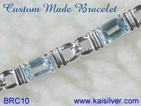 blue topaz bracelet in yellow or white gold, sterling silver topaz bracelets also available