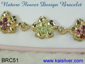 Gorgeous flower bracelet in gold or sterling silver.