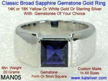white gold men's wedding band with blue sapphire gem stone