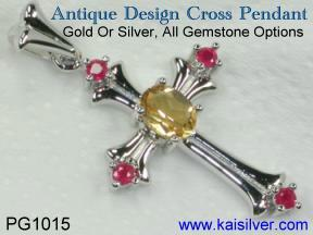 Gold or silver cross pendant with gemstone.