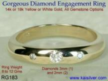 Three diamond gold ring