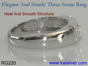 white gold ring with 3 gemstones