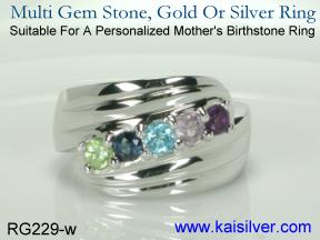 Birthstone mother ring, custom made in white or yellow gold.
